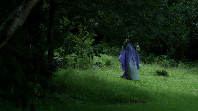 4k Fantasy Shot of a Fairy Walking Barefoot in the Forest video