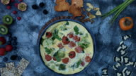 4k food composition on a vintage background with a frittata video
