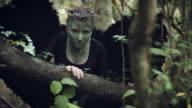 4k Halloween Dark Angel Woman with Black Wings in Forest Approaching Camera video