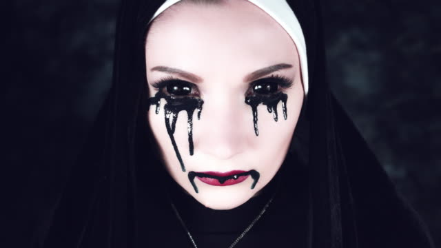 4k Halloween Shot of a Horror Nun With Black Liquid from Eyes video