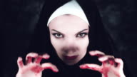 4k Halloween Shot of a Horror Woman Showing Bloody Hands video