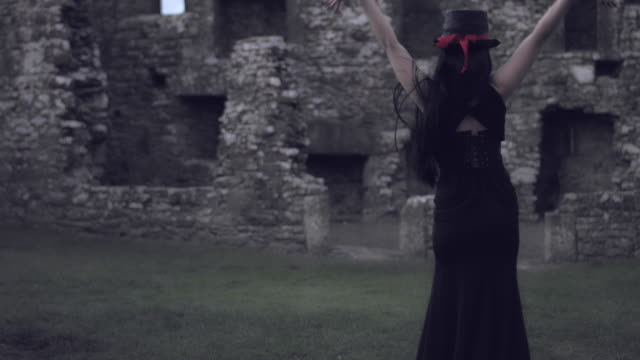 4k Halloween Shot of a Witch Dancing and turning to Camera video