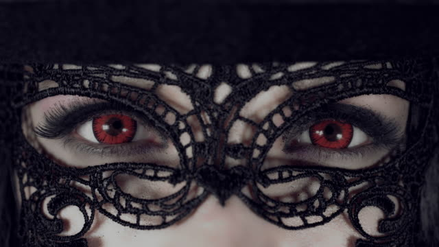 4k Halloween Shot of a Witch, Extreme Close-up of Red Eyes with Mask video