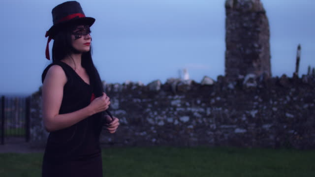 4k Halloween Shot of a Witch Looking at the Sunset video