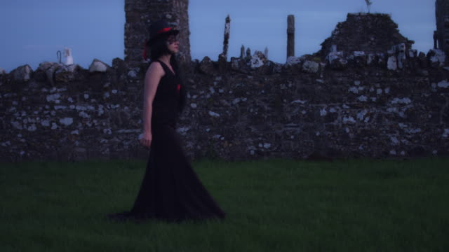 4k Halloween Shot of a Witch Walking in the Cemetery video