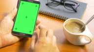 4k: hand holding blank mobile smart phone on green screen video