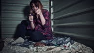 4k Homeless Drugged Woman Burning a Spoon with Drugs video
