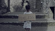 4k Horror Shot of an Abandoned Child Holding 'Homeless' on cardboard video