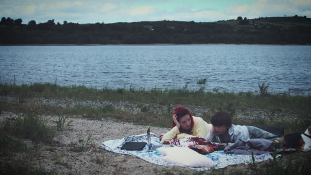 4k Mom, Son and Dog Having Picnic video