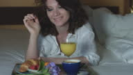 4k Morning Shot of a Sexy Woman Smelling Flower and Having Breakfast in Bed video