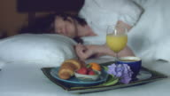 4k Morning Shot of a Sexy Woman Waking up and Having a Breakfast Surprise video
