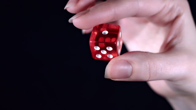 4k Poker Composition Hand Holding a Dice video