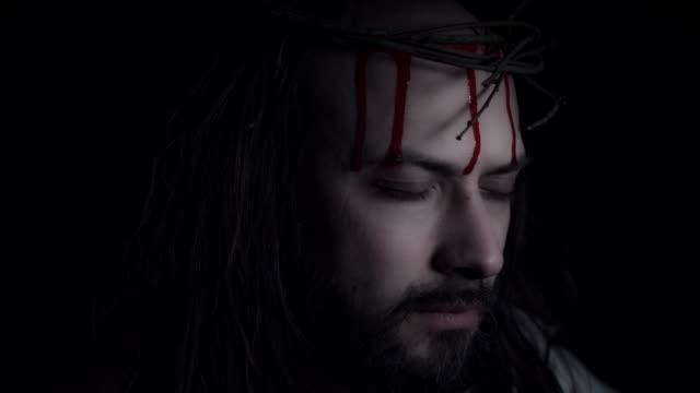 4k Religious Portrait of Jesus Parying in Pain video