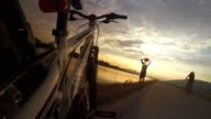4k resolution: little bicycler enjoying the sunset during rest pause video