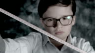 4k Science Shot of a Boy in Laboratory Playing with a Measuring Tape video