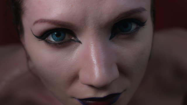 4k shoot of a horror Halloween model - Vampire eye close-up video