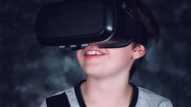 4k Shot of a Child with Virtual Reality Headset watching Smiling video