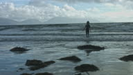4k Shot of a Dirty Beach and a Boy Playing video