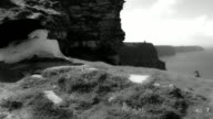 4k Shot of a Redhead princess on Cliffs of Moher View in Ireland, black & white video