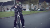 4k Sport Outdoor Child with Bicycle Stopping and Looking at his Smartwatch video