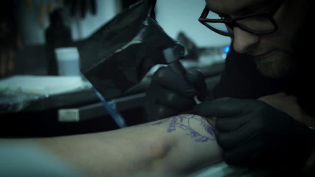 4k Tattoo Artist Tattooing Close-up video
