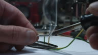 4k technical composition of a soldering iron and wires video