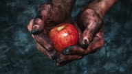 4k Technical Composition of Dirty Mechanic Hands Holding Apple video