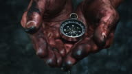 4k Technical Composition of Dirty Mechanic Hands Holding Compass video