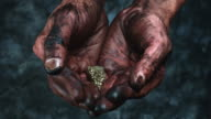 4k Technical Composition of Dirty Mechanic Hands Holding Gold Rock video