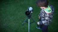 4k Technology and Astrology Child Opening his Telescope and Looking video