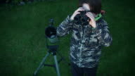 4k Technology and Astrology Child with Binoculars and Telescope Exploring video