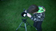 4k Technology and Astrology Child with Telescope Exploring Stars and Sky video
