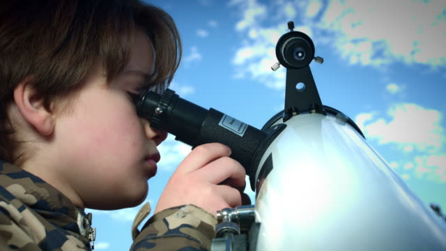 4k Technology and Astrology Child with Telescope Exploring the Sky video