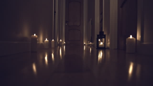 4k Thriller Shot in a Long Hall with Candles, Child opens Door video