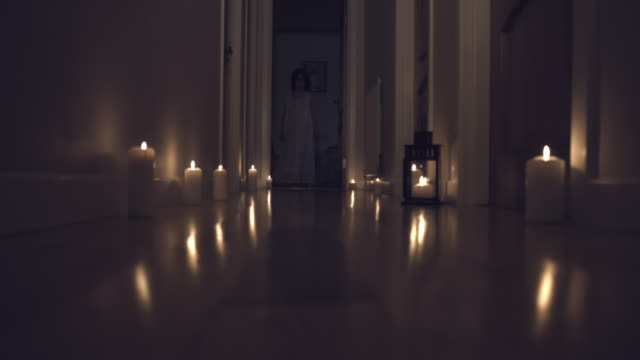 4k Thriller Shot in a Long Hall with Candles, Child walking in video