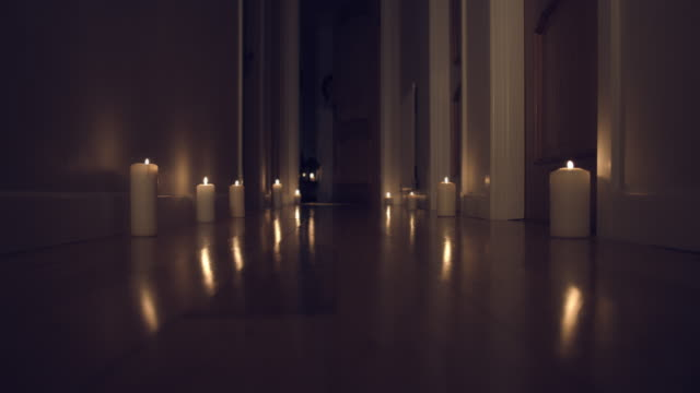 4k Thriller Shot in a Long Hall with Candles, Child walking in with a Chandelier video