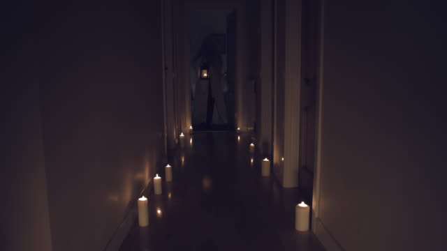 4k Thriller Shot in a Long Hall with Candles, Girl with Chandelier Moving video