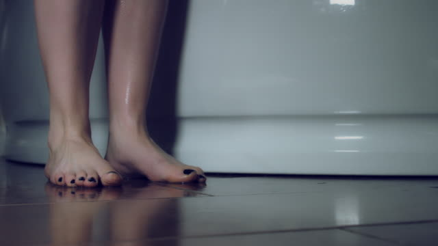 4k Thriller Shot of a Woman in Bath Room Dropping the Towel video