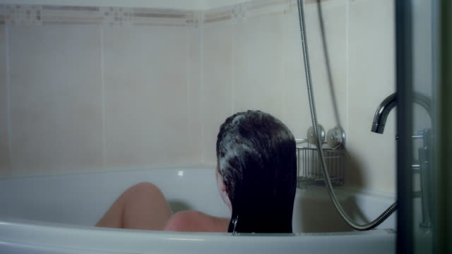 4k Thriller Shot of a Woman in Bath Room Getting out Water video