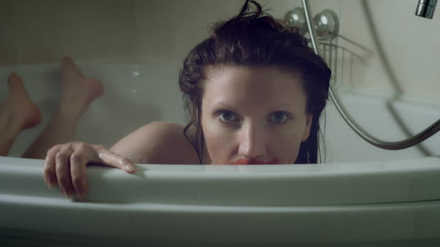 4k Thriller Shot of a Woman in Bath Room Having Blood on her Mouth video