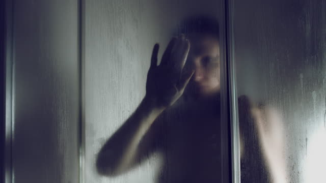 4k Thriller Shot of a Woman in Bath Room Wiping shower Window video
