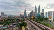 4k time lapse of dramatic sunrise at Kuala Lumpur city. Moving and changing color clouds. Aerial view. video