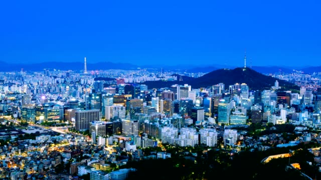 4k Timelapse of Beautiful cityscape with Seoul tower modern building and architecture in Seoul, South Korea, from day to night video