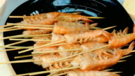 4k video. Large cooked shrimp on skewers video