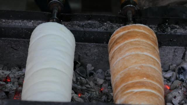 4K:Bread roll grill in christmas market video