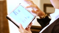 4K:Business woman looking graph on Digital tablet. video