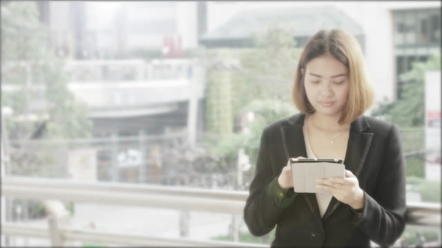 4K:Business woman using tablet in central of city video