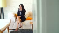 4K:Businesswoman on cellphone sitting in her room. video