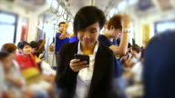 4K:Businesswoman using smartphone on train video
