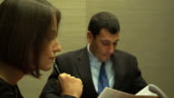 4K:Close-up of a serious businesswoman with colleagues in meeting. video